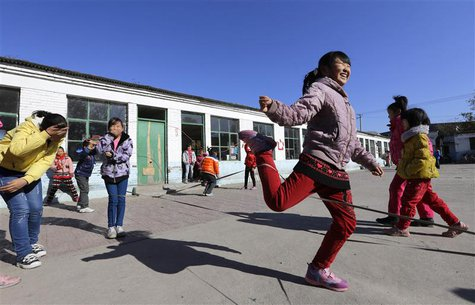 Students play a rope-skipping game during a break at Pengying School on the outskirts of Beijing November 11, 2013. REUTERS/Jason Lee
