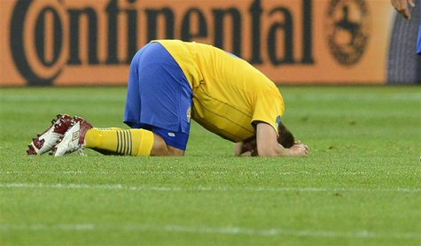 Sweden's Anders Svensson reacts to his team's defeat by England during their Group D Euro 2012 soccer match at the Olympic Stadium in Kiev,