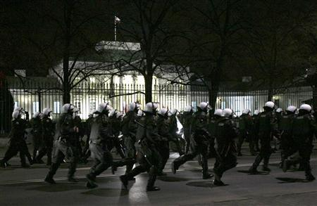 Riot policemen run to disperse far-right protesters during the annual far-right march, which coincides with Poland's national Independence Day in Warsaw November 11, 2013.  CREDIT: REUTERS/KACPER PEMPEL
