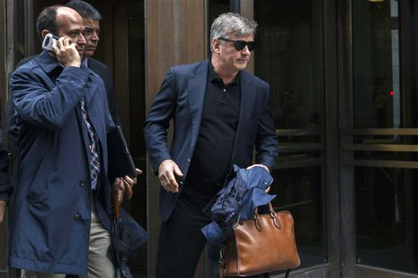 Actor Alec Baldwin (R) departs after testifying in the trial against Genevieve Sabourin at Manhattan Criminal court in New York, November 12