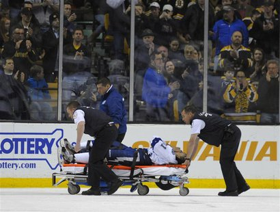 Boston, MA, USA; Tampa Bay Lightning center Steven Stamkos (91) is wheeled off on a stretcher during the second period against the Boston Br