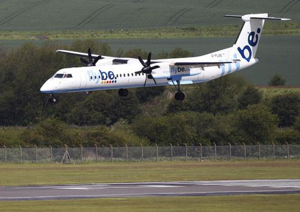A Flybe aircraft lands at Edinburgh Airport in Scotland May 24, 2011. REUTERS/David Moir