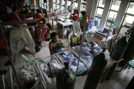 Newborn babies lie in cribs inside a chapel which was turned into a makeshift hospital after Super Typhoon Haiyan battered Tacloban city in