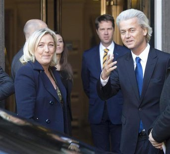 Netherland's anti-Islamic party leader Geert Wilders (R) welcomes far-right leader Marine Le Pen of France in The Hague, Netherlands, Novemb