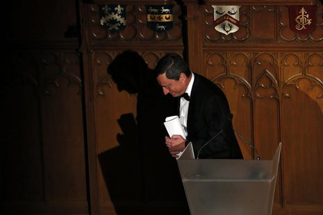 President of the European Central Bank Mario Draghi leaves the stage after delivering a speech on the future of Europe at the Guildhall in c