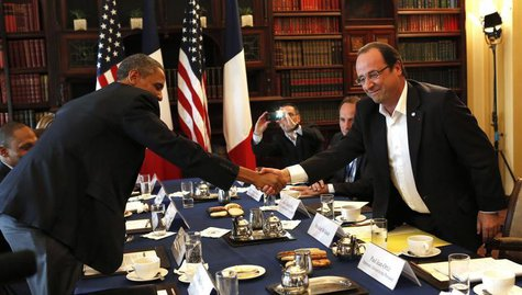 U.S. President Barack Obama (L) shakes hands with French President Francois Hollande during their meeting at the G8 Summit in Enniskillen, N