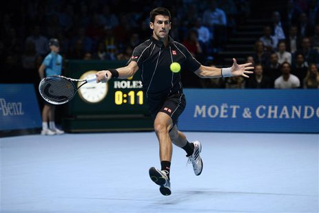Novak Djokovic of Serbia plays a shot to Rafael Nadal of Spain during their their men's final singles tennis match at the ATP World Tour Fin