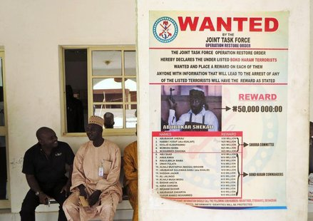 A poster advertising for the search of Boko Haram leader Abubakar Shekau is pasted on a wall in Baga village on the outskirts of Maiduguri,