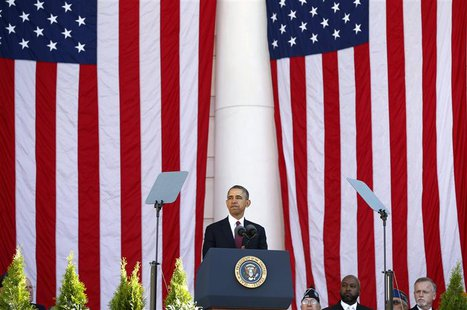 U.S. President Barack Obama speaks during a Veterans Day ceremony at Arlington National Cemetery in Washington November 11, 2013. REUTERS/Ke