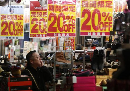 A man looks at items in a shoe store at a shopping district in Tokyo in this October 24, 2013 file photo. REUTERS/Yuya Shino/Files