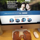 A man looks over the Affordable Care Act (commonly known as Obamacare) signup page on the HealthCare.gov website in New York in this October