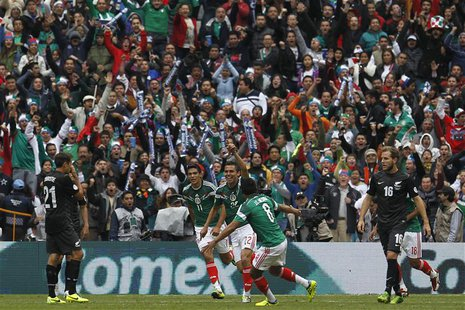 Mexico's Paul Aguilar (C) celebrates his goal with Raul Jimenez (L) and Juan Medina during their 2014 World Cup qualifying playoff first leg