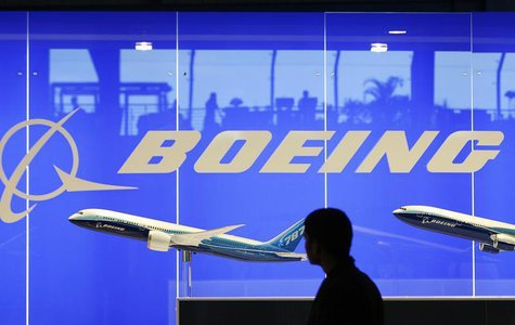A man looks at a scale model of Boeing's 787 dreamliner at their booth at the Singapore Air Show in Singapore February 19, 2008. REUTERS/Viv