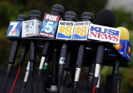 Microphones from San Diego media and news outlets are gathered for a news conference in San Diego July 11, 2013. REUTERS/Mike Blake