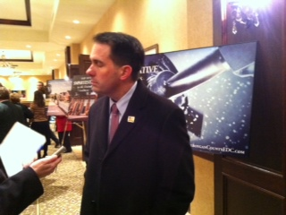 Governor Walker meets with reporters inside of the Osthoff Convention Center.