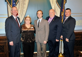 (l-r) Sen. Bruce Caswell, Disabled American Veterans Auxiliary state Commander Anna Lockwood, Lt. Gov. Brian Calley, state Rep. Kenneth Kurtz, and Nicholas Cook from the DMVA.