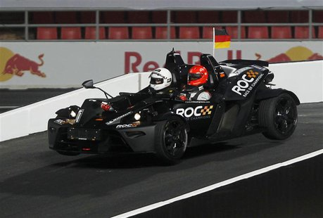 Driver Michael Schumacher (R) drives during the Race of Champions (ROC) Nations Cup at Rajamangala National Stadium in Bangkok December 15,