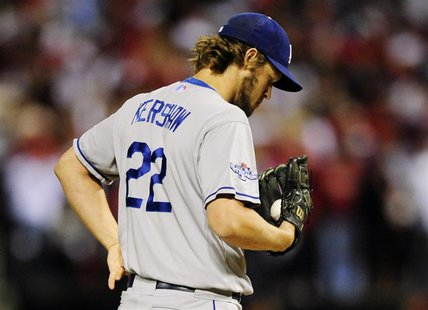 St. Louis, MO, USA; Los Angeles Dodgers starting pitcher Clayton Kershaw reacts during the third inning against the St. Louis Cardinals in g