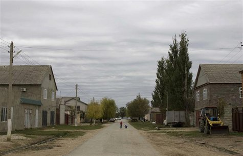 Children walk in a street in Novosasitli village in the Dagestan region, September 28, 2013. Moscow now fears that hundreds of Russian-born