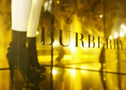 A mannequin is displayed in a window of Burberry's in central London May 28, 2008. REUTERS/Luke MacGregor