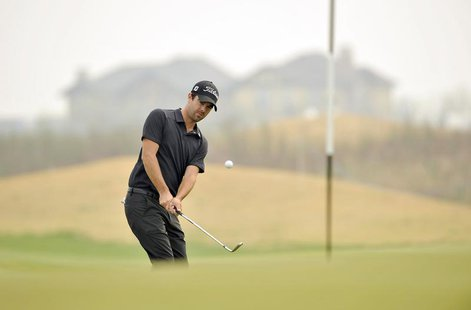 Nick Cullen of Australia watches his shot during the Championship Pro-Am of Volvo China Open at Binhai Lake Golf Club in Tianjin April 18, 2