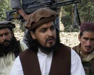 Pakistani Taliban chief Hakimullah Mehsud (C) sits with other millitants in South Waziristan October 4, 2009 in this video grab taken from f