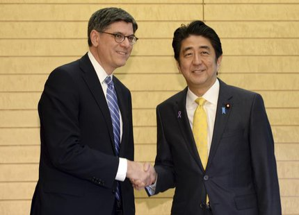 U.S. Treasury Secretary Jack Lew (L) shakes hands with Japan's Prime Minister Shinzo Abe at the start of their meeting at Abe's official res