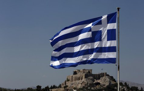 A Greek flag flutters in front of the Acropolis hill in Athens August 21, 2013. REUTERS/John Kolesidis