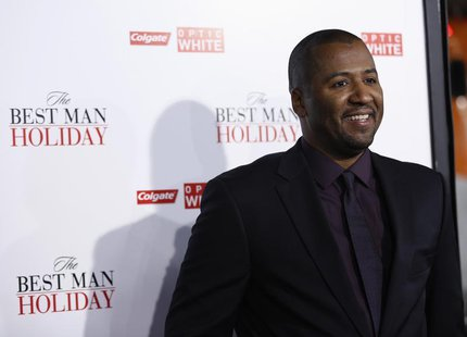 "Director of the movie Malcolm D. Lee poses at the premiere of ""The Best Man Holiday"" in Hollywood, California November 5, 2013. The movie op"