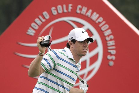 Rory McIlroy of Northern Ireland reacts after teeing off on the eighth hole during the third round of the WGC-HSBC Champions golf tournament