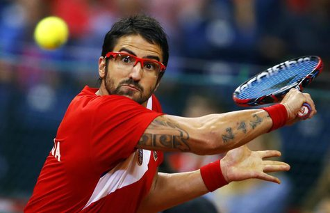 Serbia's Janko Tipsarevic returns the ball to Canada's Vasek Pospisil during their Davis Cup semi-final tennis match in Belgrade September 1