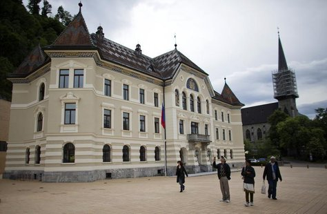 People walk in front of Liechtenstein's government building in Vaduz, May 15, 2013. REUTERS/Michael Buholzer