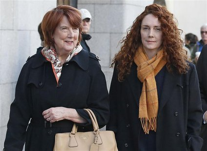 Former News International chief executive Rebekah Brooks (R) arrives with her mother Deborah Wade at the Old Bailey courthouse in London Nov