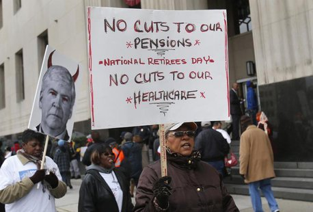 Protesters demonstrate against cuts in Detroit city workers' pensions and healthcare, outside Theodore Levin U.S. Courthouse during Detroit'