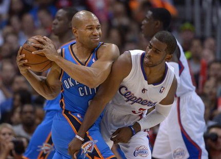Nov 13, 2013; Los Angeles, CA, USA; Oklahoma City Thunder guard Derek Fisher (2) is defended by Los Angeles Clippers guard Chris Paul (3) at
