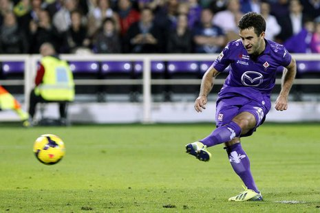 Fiorentina's Giuseppe Rossi scores a penalty against Napoli during their Italian Serie A soccer match at the Artemio Franchi stadium in Flor