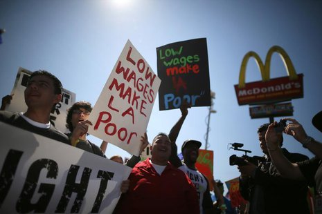 Workers and their supporters protest outside McDonald's as part of a nationwide strike by fast-food workers to call for wages of $15 an hour