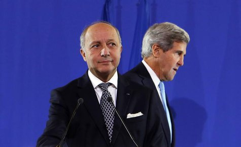 U.S. Secretary of State John Kerry (R) joins French Foreign Minister Laurent Fabius at a news conference after a meeting regarding Syria, at