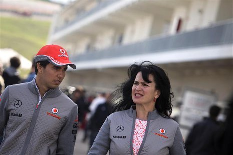 McLaren Formula One driver Sergio Perez (L) of Mexico arrives to the track at the Circuit of The Americas in Austin, Texas November 14, 2013
