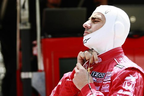 Target Chip Ganassi Racing driver Dario Franchitti of Scotland adjusts his driving suit during a practice session at the Indianapolis Motor