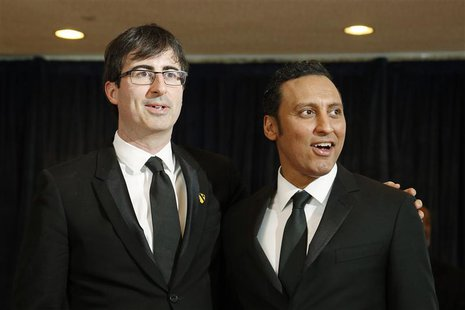 Comedians John Oliver (L) and Aasif Mandvi arrive on the red carpet at the annual White House Correspondents' Association dinner in Washingt
