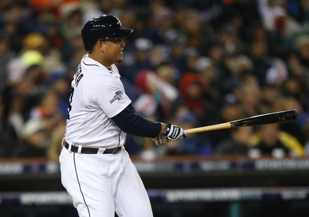 Detroit Tigers third baseman Miguel Cabrera (24) hits an RBI single against the Boston Red Sox during the fifth inning in game five of the A