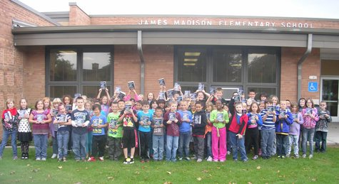 James Madison Elementary School third grade students show off their new dictionaries.