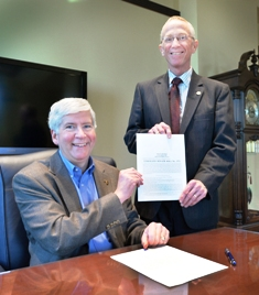 Michigan Governor Rick Snyder and State Senator Bruce Caswell at signing of Senate Bill 372