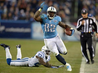 Nov 14, 2013; Nashville, TN, USA; Tennessee Titans tight end Delanie Walker (82) is pursued by Indianapolis Colts cornerback Vontae Davis (2
