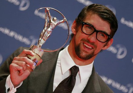 U.S. Olympic swimmer Michael Phelps poses with his Special Laureus Award during the 2013 Laureus World Sports Awards, at Municipal Theater i