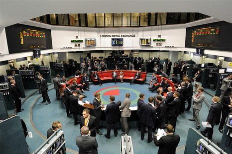 Traders and clerks work at the London Metal Exchange (LME) in London, in this July 22, 2011 file photo. REUTERS/Paul Hackett/Files