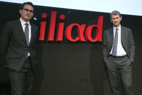 Maxime Lombardini (R), Chief Executive Officer of French broadband Internet provider Iliad, and Thomas Reynaud, Chief Financial Officer of I