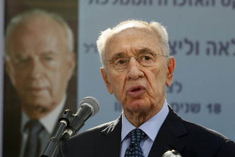 Israeli President Shimon Peres gives a speech during a ceremony for late Israeli prime minister Yitzhak Rabin at the Mount Herzl cemetery in