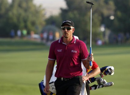 Henrik Stenson of Sweden swings his club as he arrives on the 18th hole during the second round of the DP World Tour Championship golf tourn
